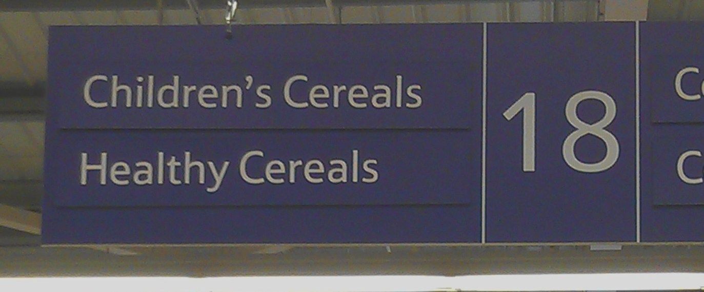 "Supermarket aisle sign with ""Healthy Cereals"" and ""Childrens Cereals"""